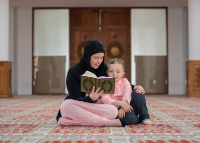 teacher tutor the child to reading koran book